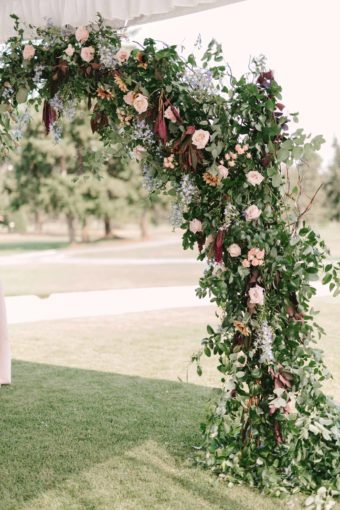 wedding arch with greenery and flowers