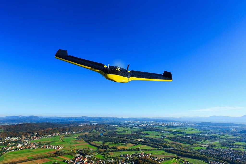 a yellow colored fixed-wing senseFly drone