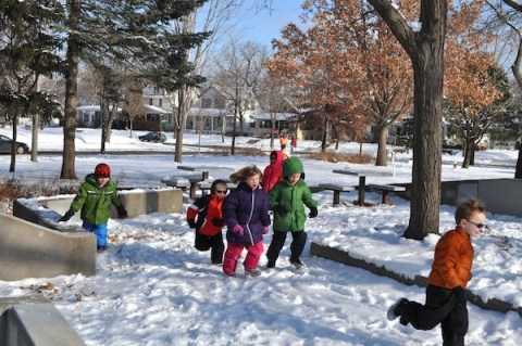 Kindergartners running at recess.