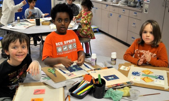 First and second graders work on quilts in art after learning about the work of Faith Ringgold.