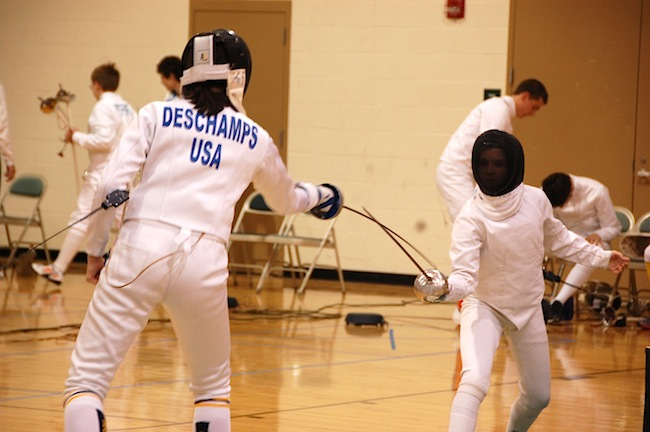 "Emma gets the ""touch"" while competing in epee at the Minnesota State"