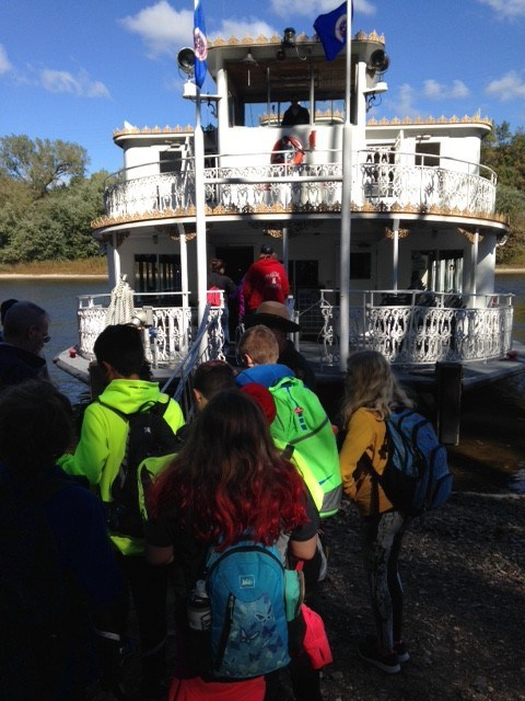 FSMN 5th and 6th graders board a riverboat to explore the Mississippi River.