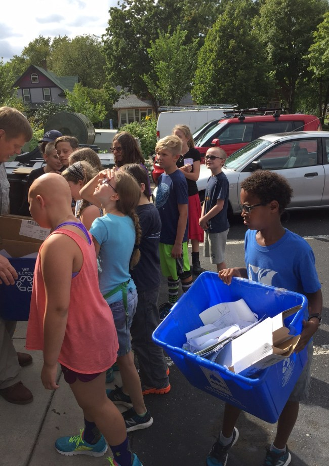 On the first day of school, middle school science/math teacher Steve Moe teaches 5th and 6th graders how to run the school's recycling program.