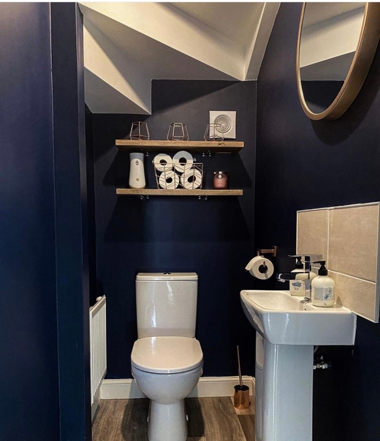 set of two rustic floating shelves in dark blue walled downstairs toilet