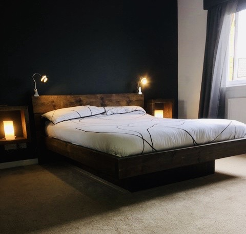 floating solid wood bed in dark bedroom
