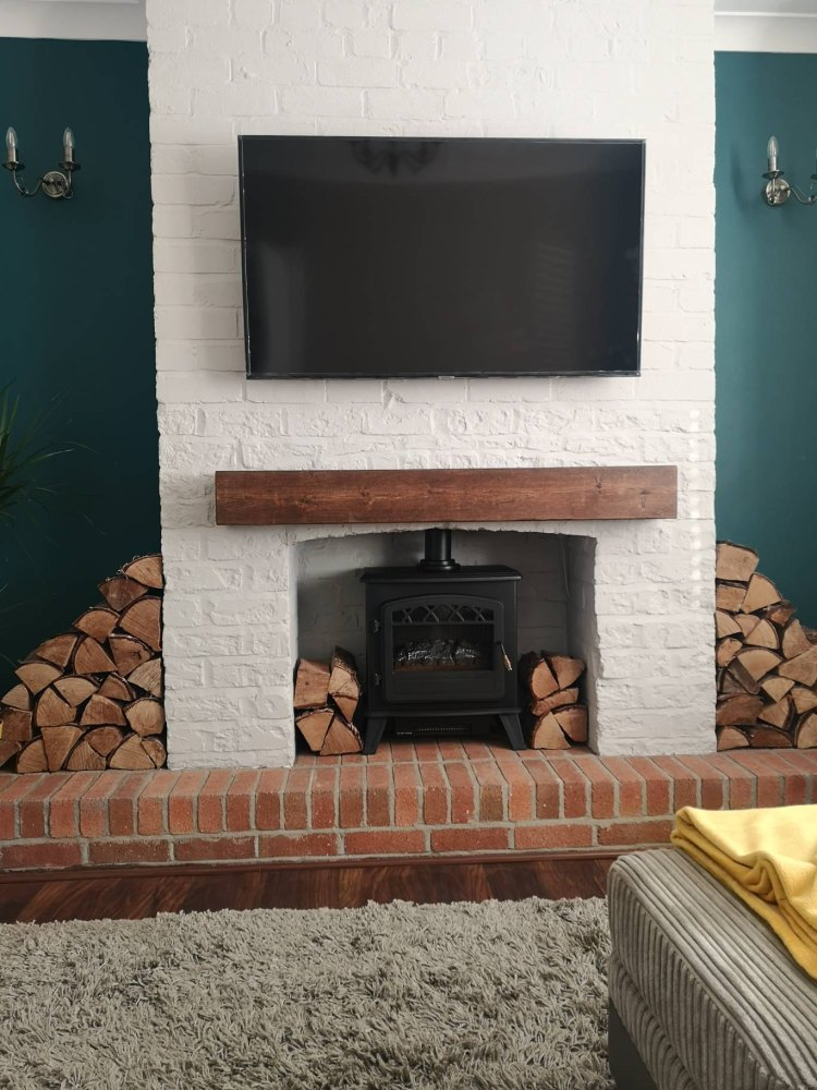 exposed brickwork mantel with blue walls