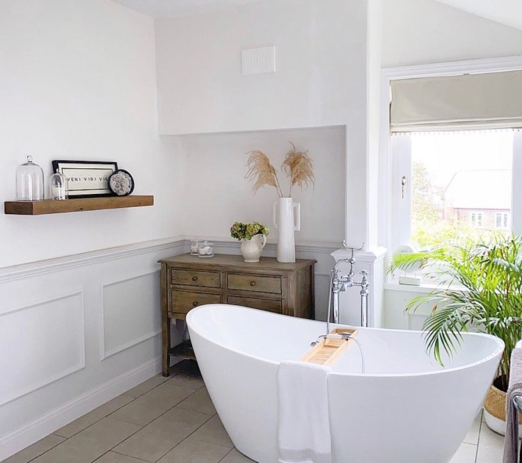 White bathroom sanctuary with floating wooden shelf
