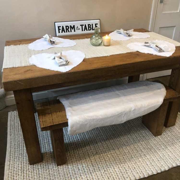 farmhouse style solid wood dining table in neutral kitchen diner.