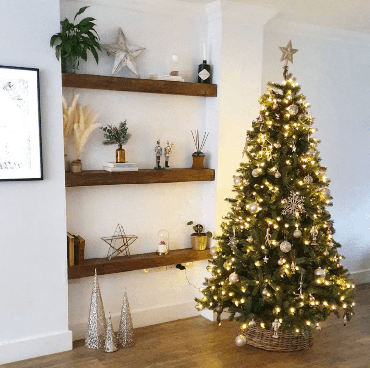 shelving in alcove in living room next to Christmas tree