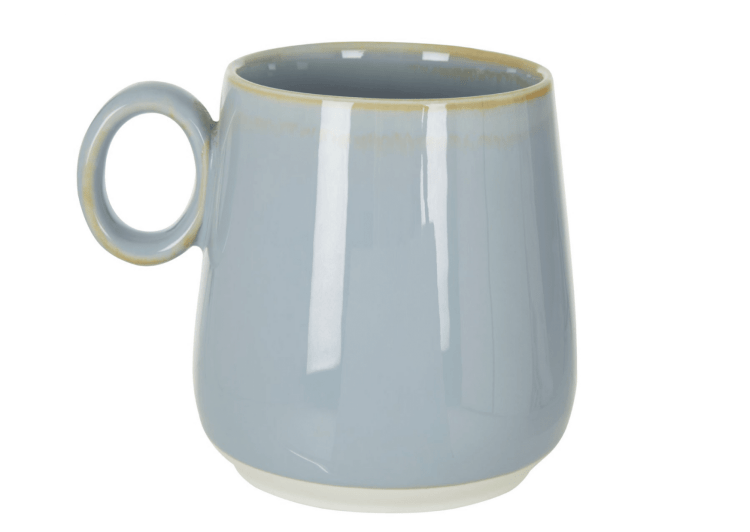 This image is of our dusky blue mug, the handle is on the left hand side and it is round in shape.