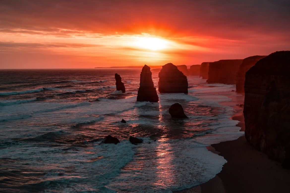 sunset behind stone spires on a beach in Australia