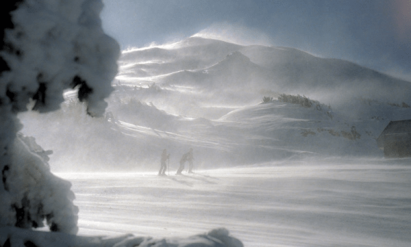 hikers in a blizzard with low visibility
