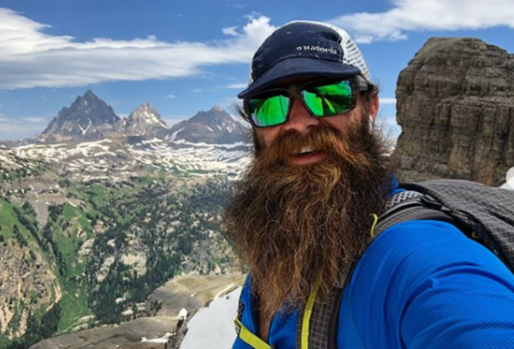 Thomas Gathman, also known as the Real Hiking Viking, with mountains in the background.