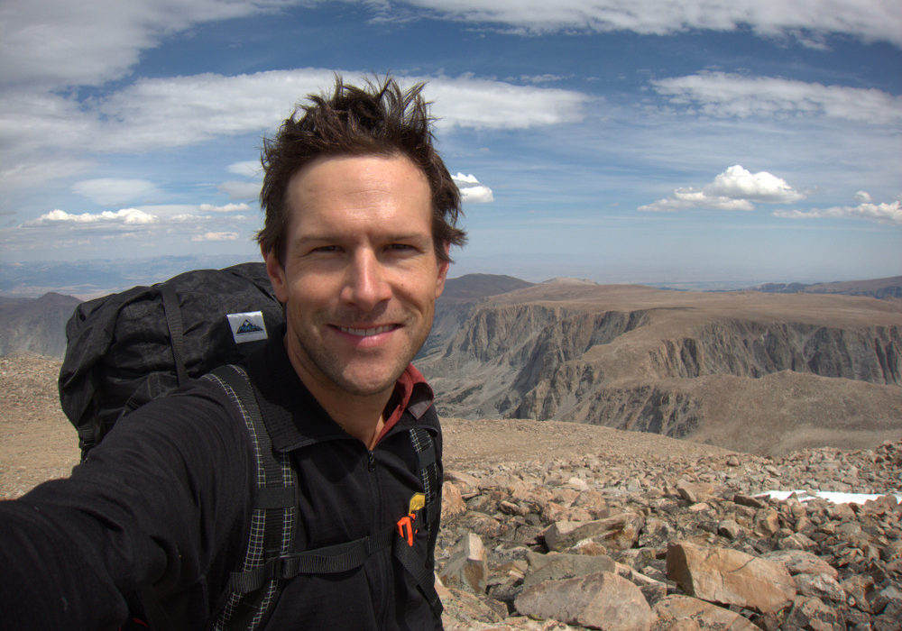 Andrew Skurka, backcountry navigation expert, with mountains in the background.