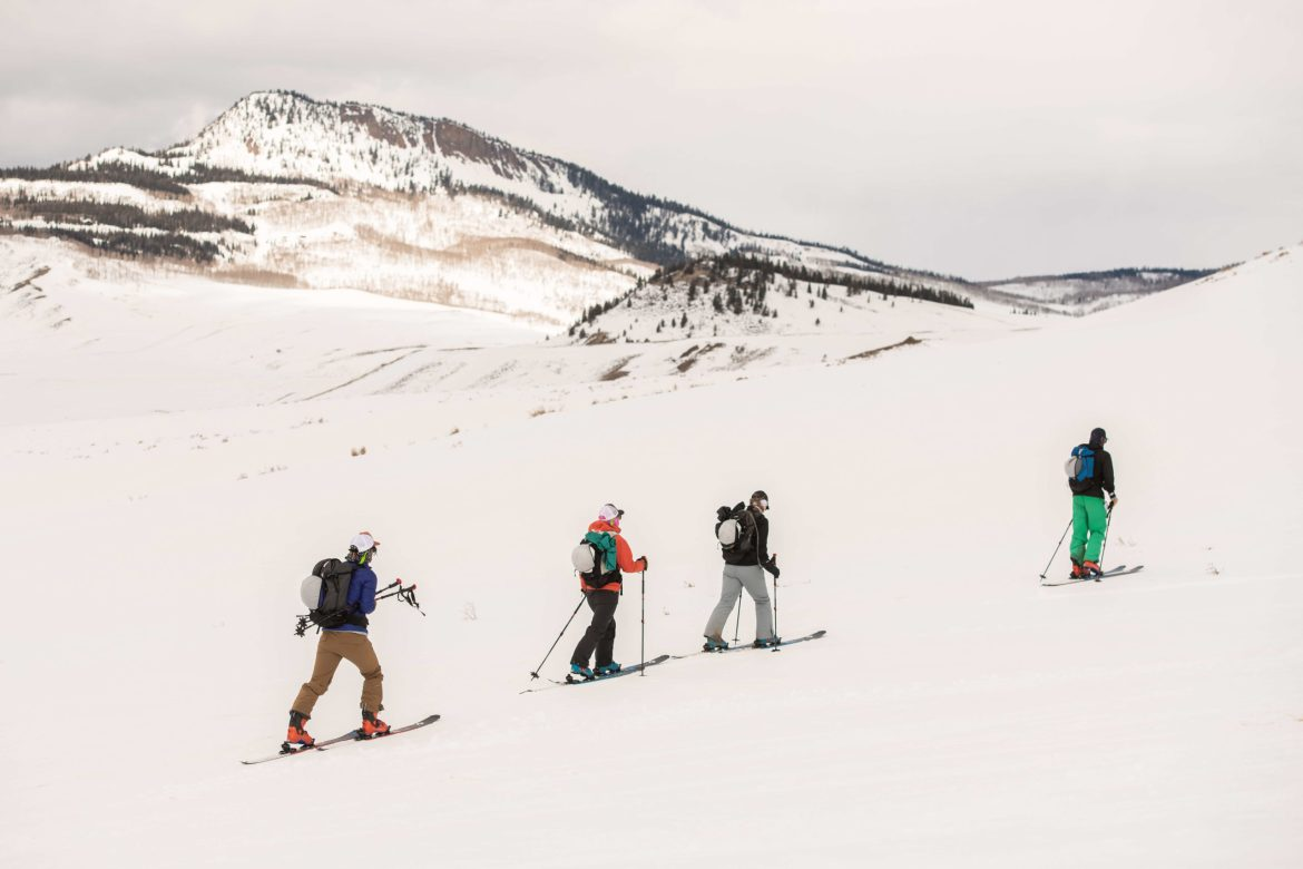 Four backcountry skiers skin up a slope outside Steamboat Springs, CO.