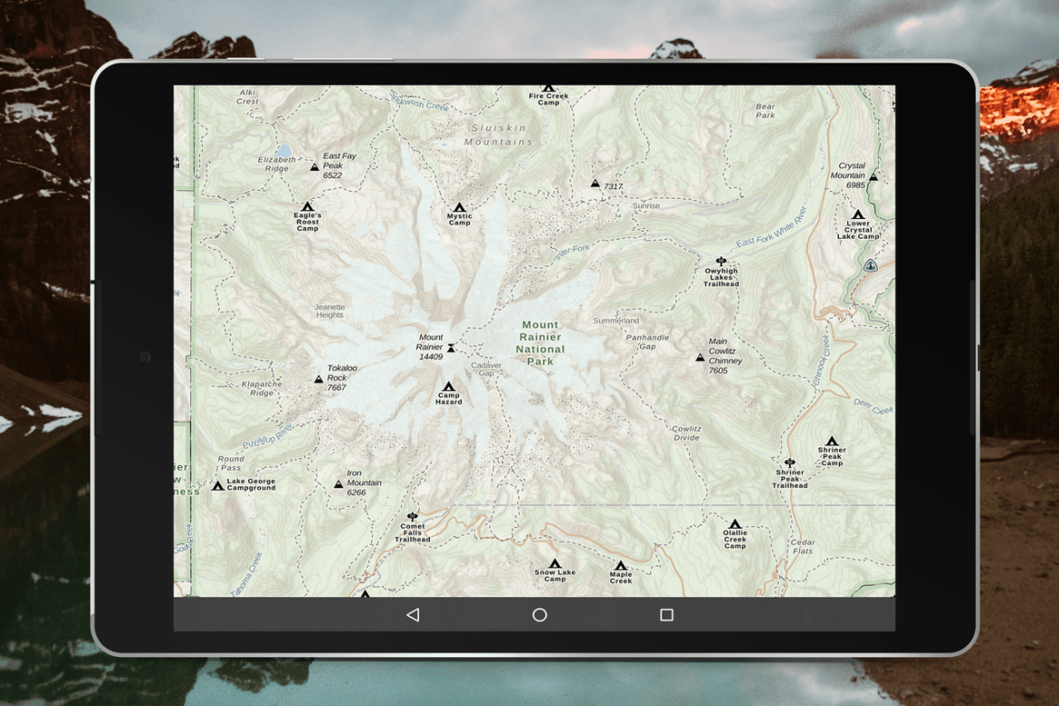 A tablet screenshot of Gaia Topo shows the peaks, campsites, and trails in Mount Rainer National Park.
