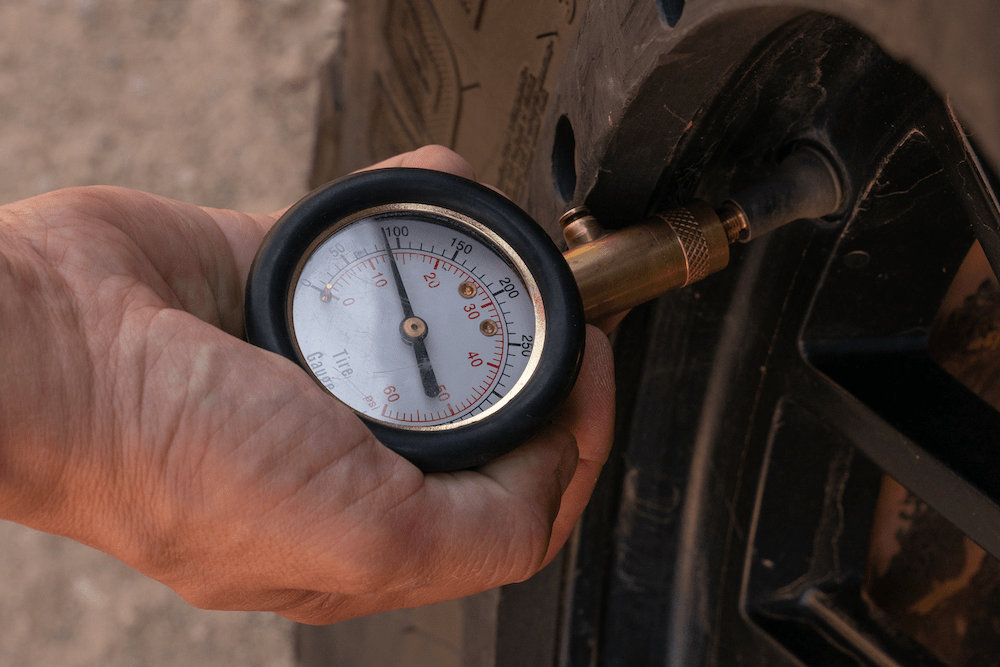 Pressure gauge letting air out of a tire