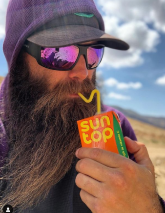 Hiking Viking drinking from a juice box.