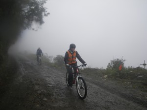 Jane on her bike, riding down the world's most dangerous road.
