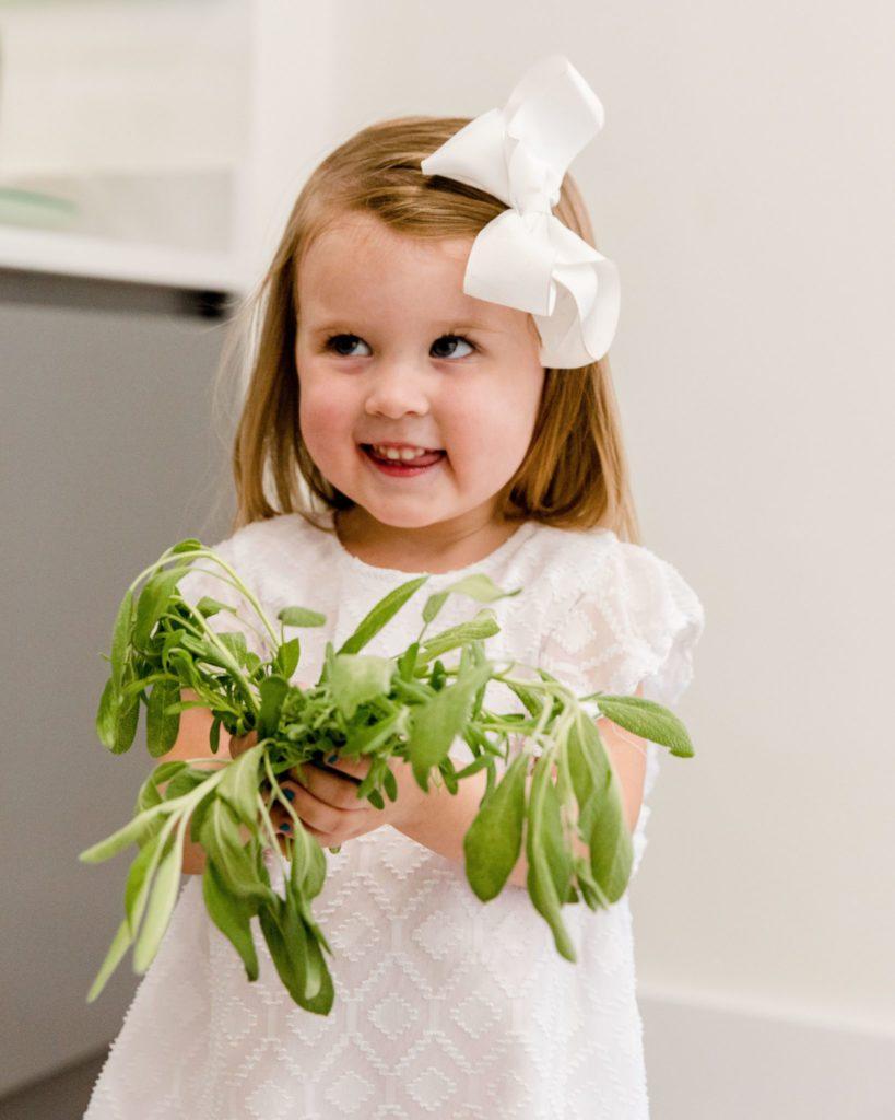future foodie holding fresh harvest