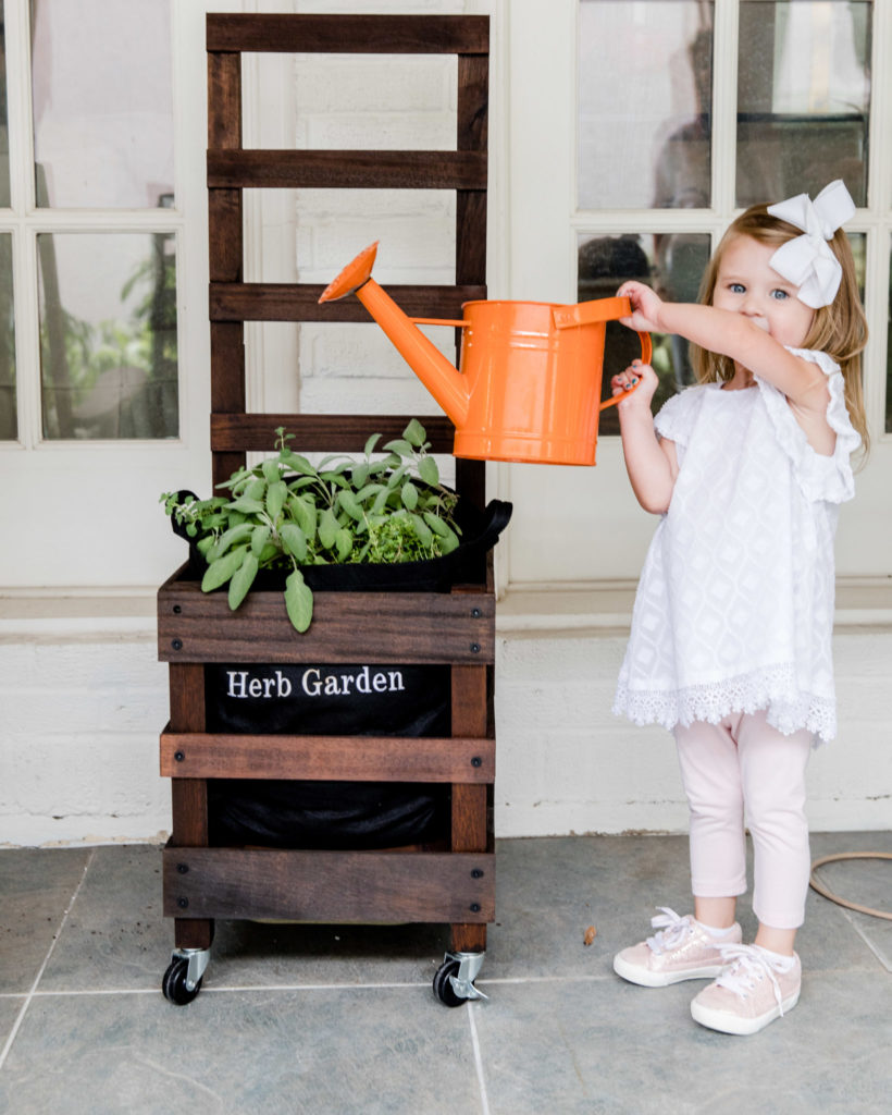 Child Watering Gardenuity Container Garden