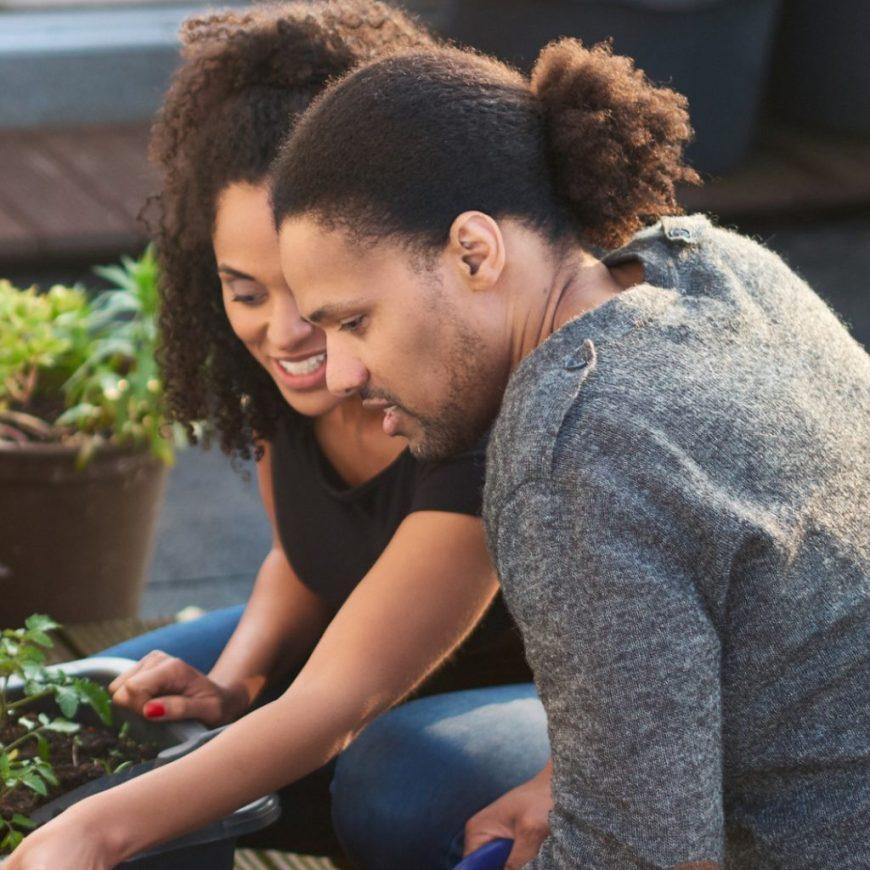 first time gardeners carefully tending their gardener
