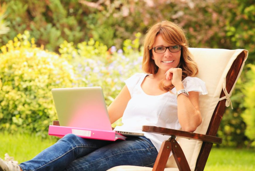 Woman Reading on Laptop about Gardening Tips