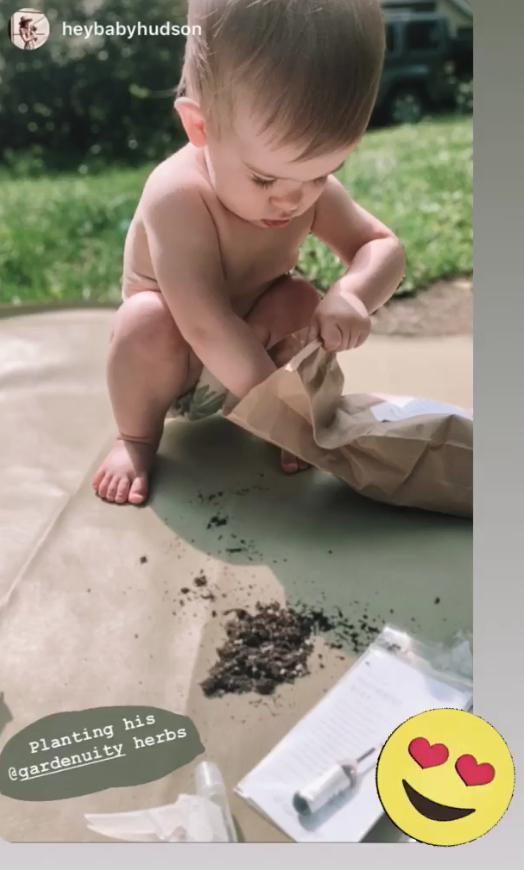 Child putting together his gardenuity garden