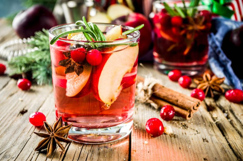 Warm Sangria Cocktail With Apples, Wine, Cranberry, & Rosemary