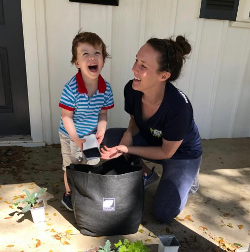 Working Mother with Her Son Planting a Gardenuity Garden Kit Outdoors