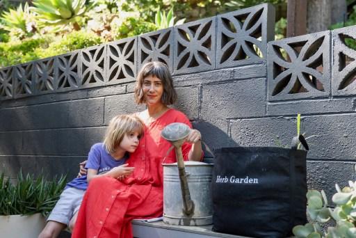 Woman with Son & Garden