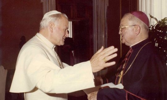 Bishop James Hogan, right, and Pope John Paul II in Rome.