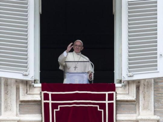 Pope Francis delivers his blessing during the Regina Coeli prayer from his studio's window overlooking St. Peter's Square, at the Vatican