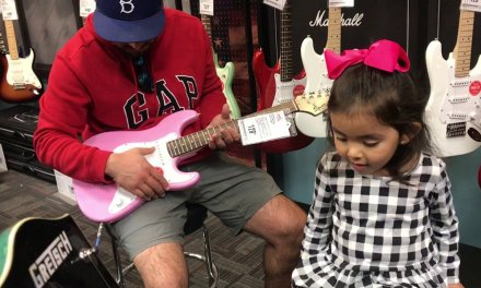 Zoe and daddy test out the electric guitars!