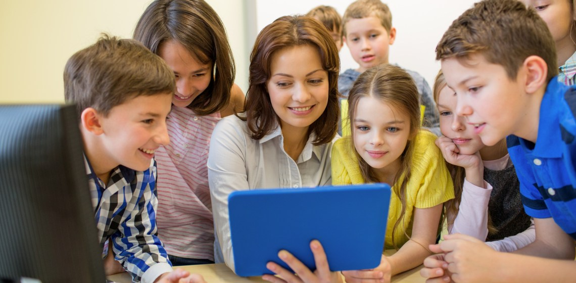 Teacher with students and tablet