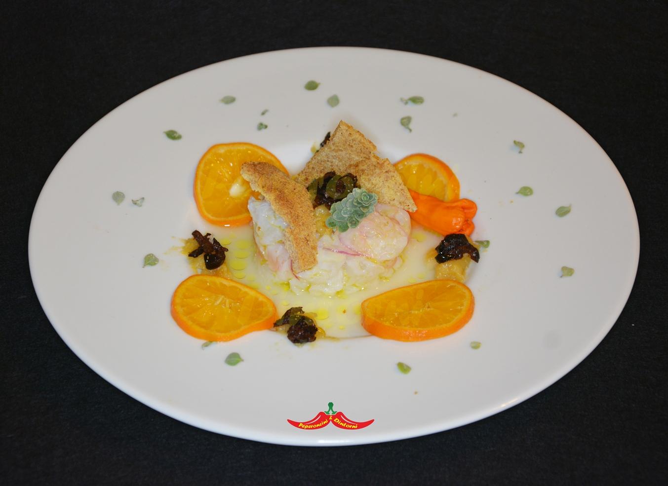 Baccalà marinato alle clementine, con salsa al rum e olive al forno