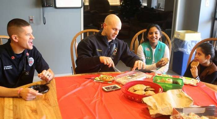 Muslim Girl Scouts Bring Christmas Breakfast to Naperville Firefighters