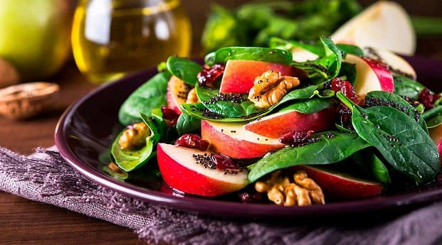 Healthy food restaurants in Barcelona offer healthy dishes like this apple, spinach and dried fruit salad.