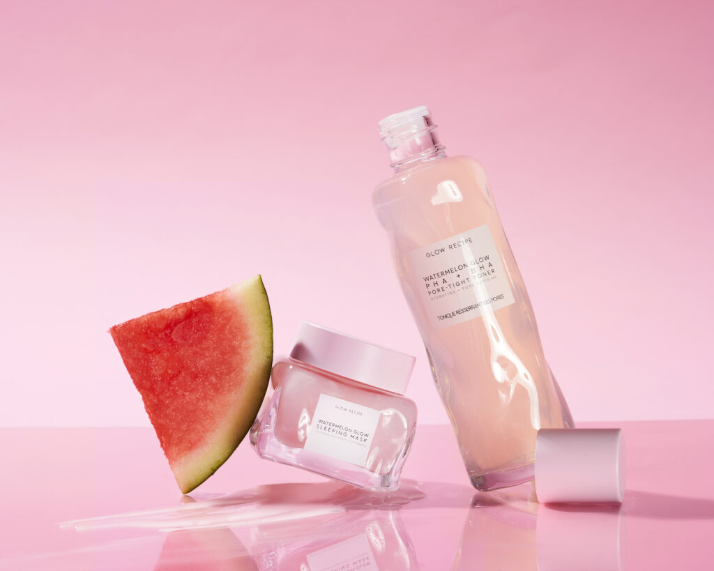 Glow Recipe Watermelon Glow Sleeping Mask and Watermelon Glow PHA+BHA Pore-Tight Toner with a slice of watermelon