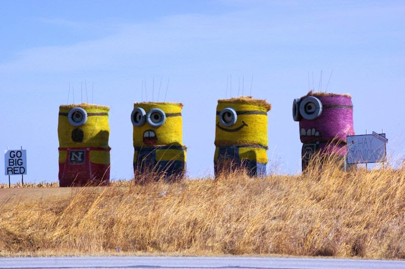 Four Minions standing together