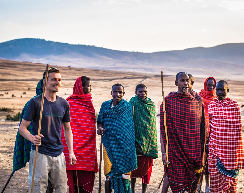 Man in desert with indigenous tribe