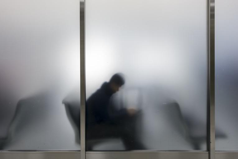 Man behind window