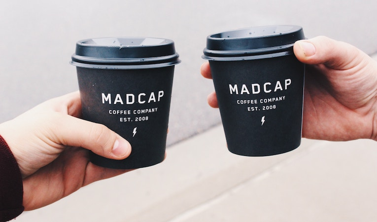two black branded coffee cups