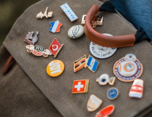 logo pins on a purse