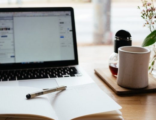 journal sitting open in front of a laptop