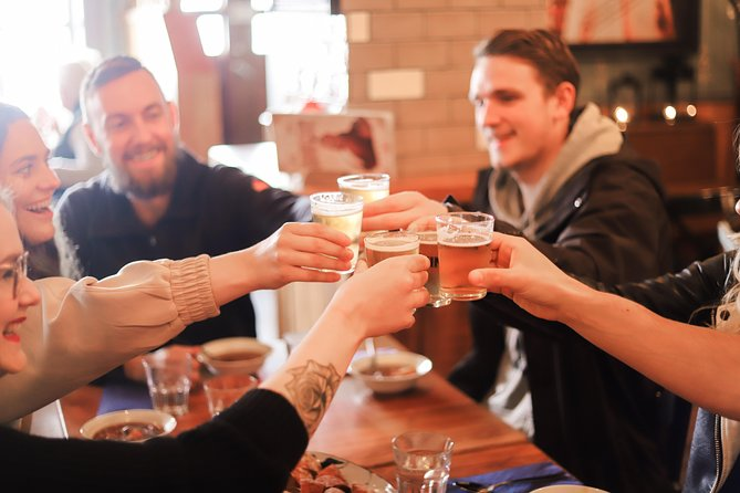 Group of people toasting in a restaurant during a food tour of Reykjavik