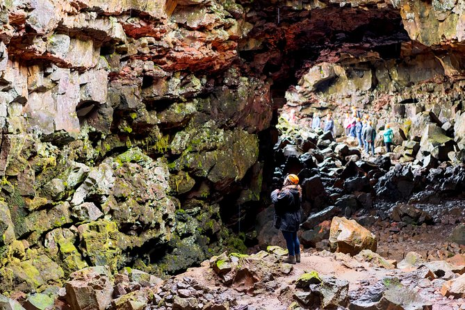 Person taking a tour of the Raufarhólshellir Lava Tunnel in Iceland