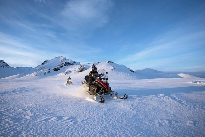 Two people snowmobiling on a tour near Reykjavik, Iceland