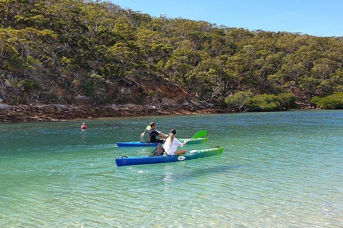 Two people kayaking near Great Keppel Island in Australia.
