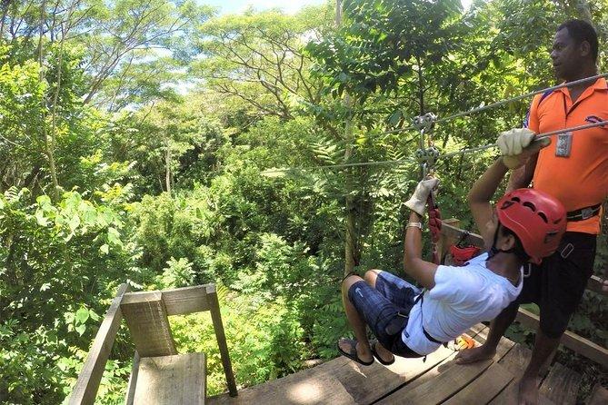 A tourist ziplining through the jungle on their trip to Fiji.